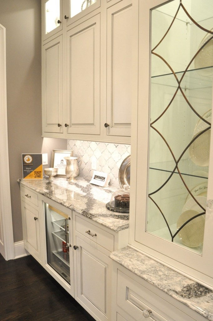 White kitchen with leaded glass doors