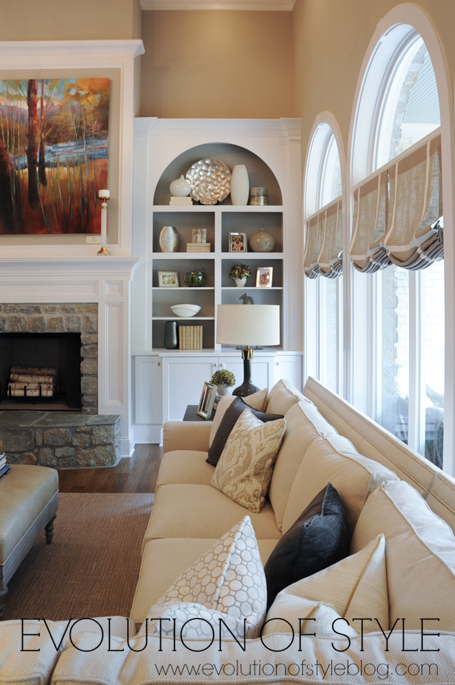 Great room with built ins and large windows