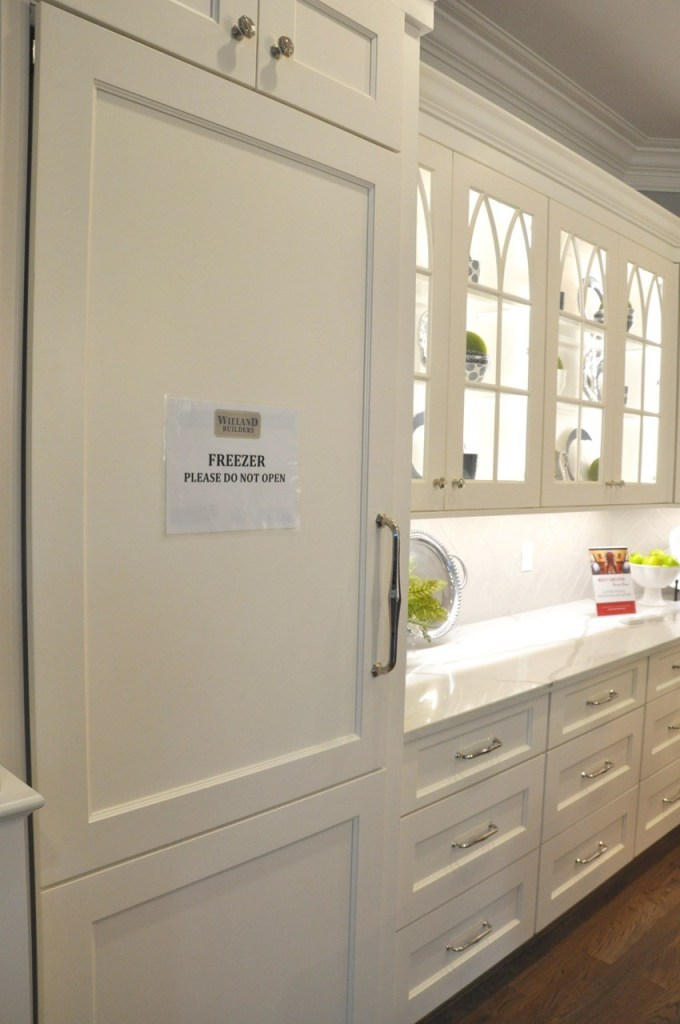 White kitchen with glass doors