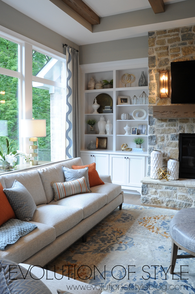 Living room with built-ins and stone fireplace
