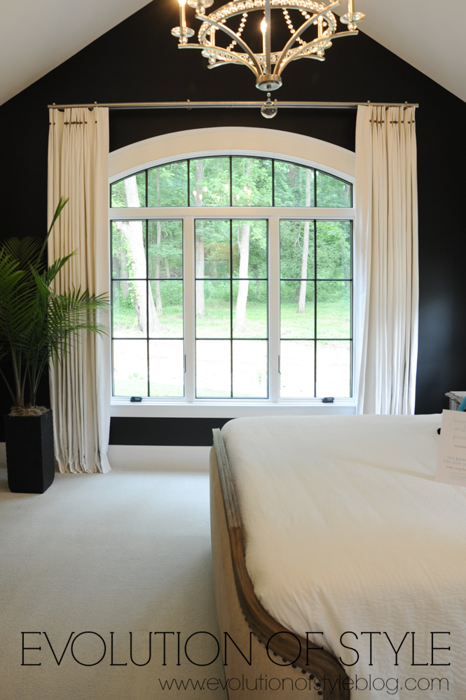 Master bedroom with dark accent wall