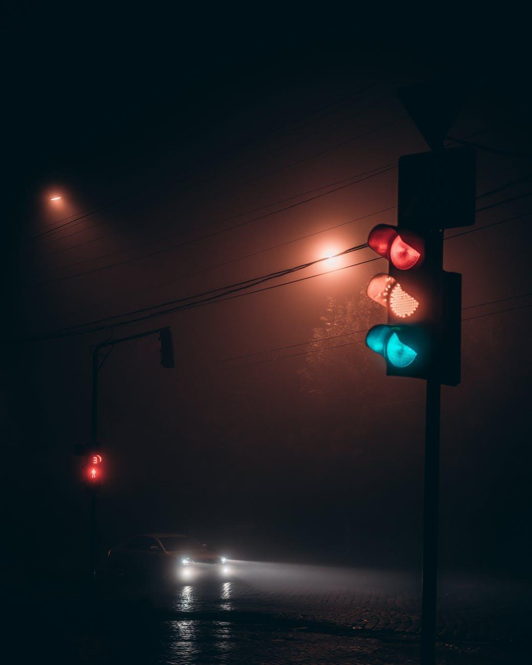 traffic light on road at night