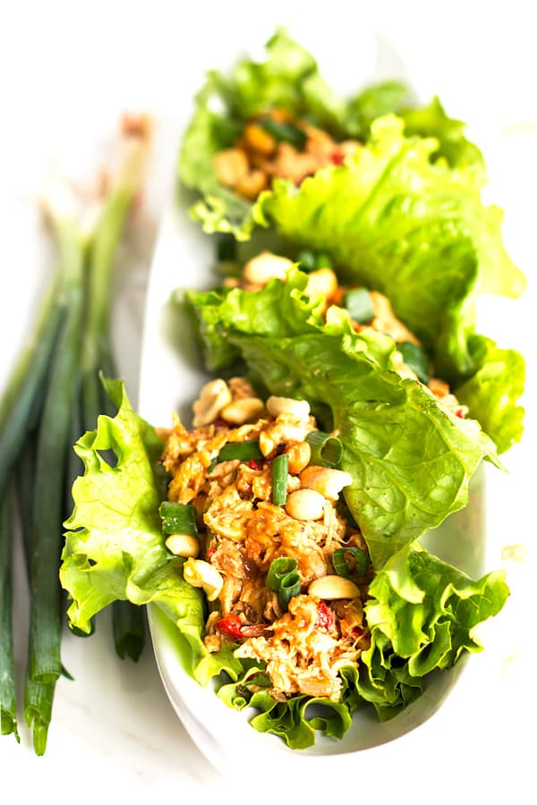 Peanut Asian Chicken Lettuce Wraps are a healthy gluten-free, low-carb and Paleo lunch or dinner recipe that does not require any cooking to whip up!