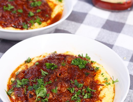 Braised beef ragu, a hearty, flavorful tomato sauce with beautiful braised and slow cooked meat on top of a smooth and creamy polenta!