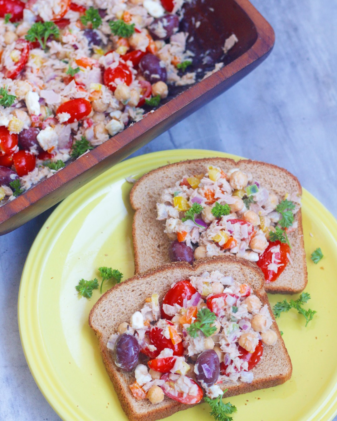 The BEST Mediterranean Tuna Salad ever with fresh herbs, chickpeas, and a medley of vegetables! So easy to make and perfect for lunches on the go!