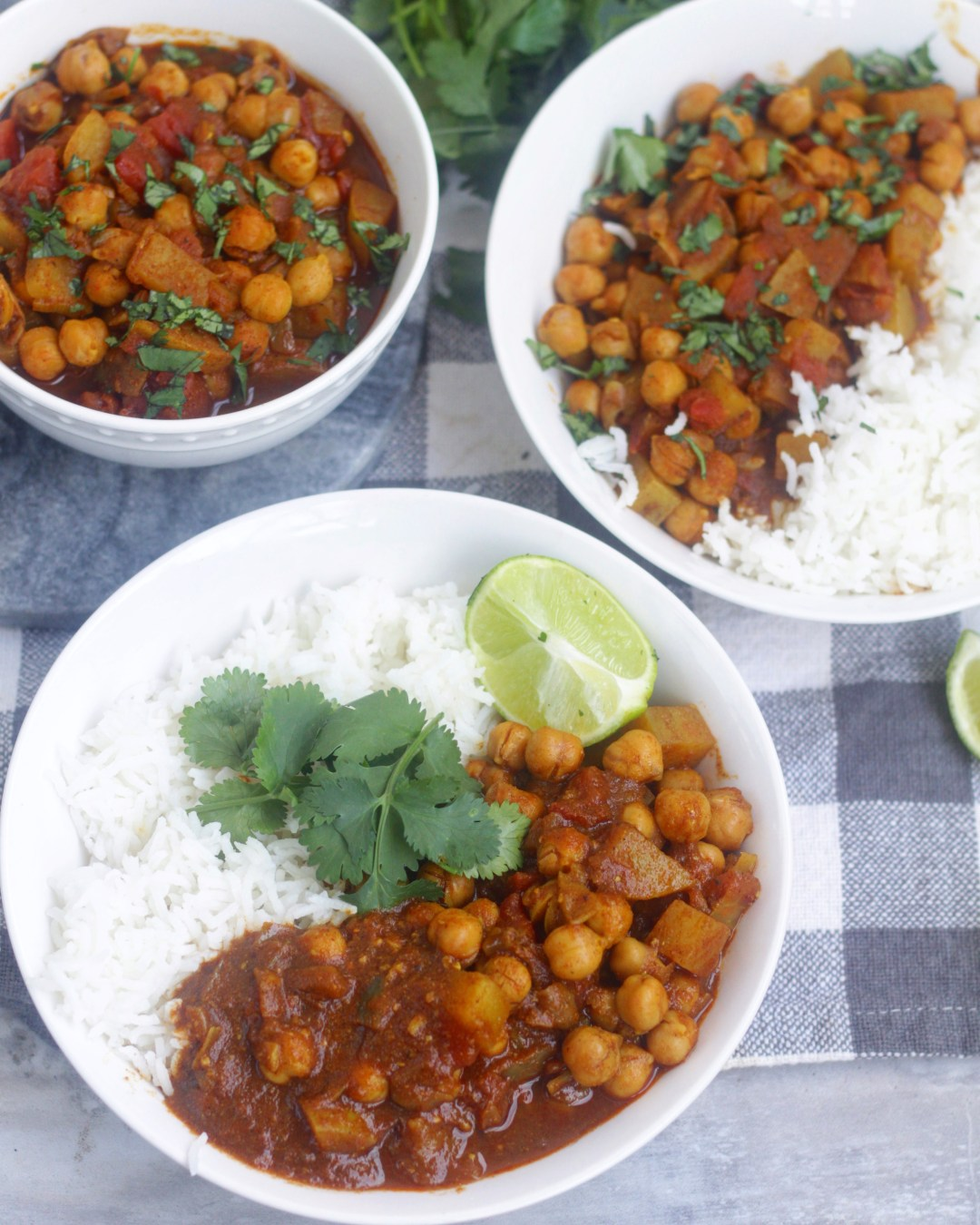 This vegan chickpea & potato curry is a healthy and comforting dish that's perfect for weeknight dinners! With a Caribbean flavor base, the spices are bold and delicious!#sponsored