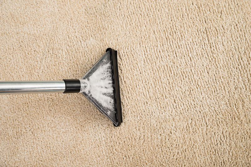 45688052 – high angle view of electric vacuum cleaner over carpet with foam