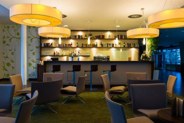 19054663 – nice hotel lounge bar with bottle shelfs and seats, tables, lights