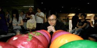 Vickson praying to win bowling tournament