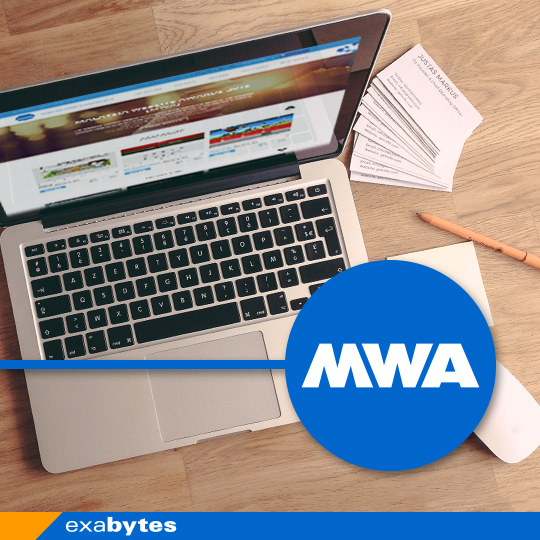 MWA logo with laptop background
