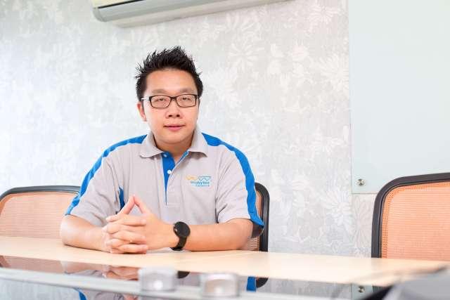 Chan Kee Siak sitting in meeting room