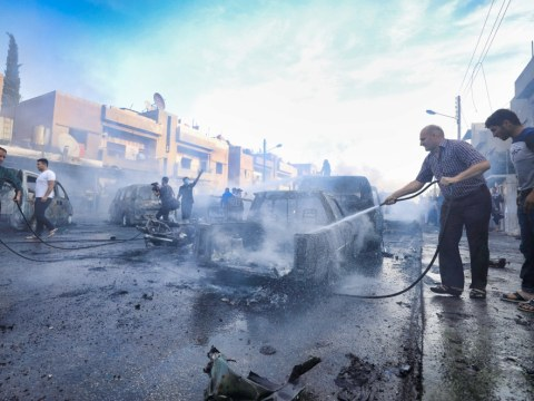 Putting out fires in Qamishli, Syria, on October 11. Photo: CNS/Reuters