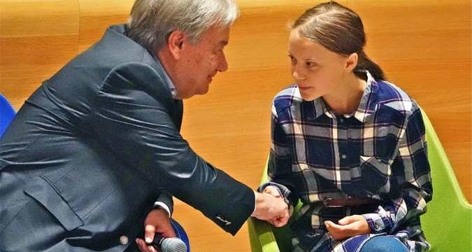 Secretary-General of the United Nations, Antonio Guterres, greets 16-year-old Swedish climate activist Greta Thunberg on September 21 during the Youth Climate Summit at the headquarters of the United Nations in New York City. Photo: CNS/Reuters