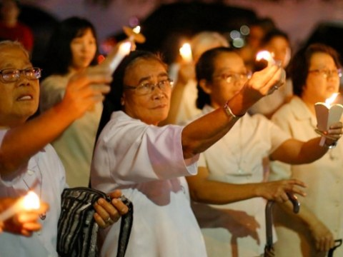 Nuns join a candlelit march in Manila on November 5 protesting alleged attacks against Church workers and human rights activists. Photo: UCAN/Jire Carreon