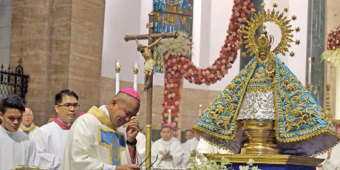 Bishop Dialogo sheds tears before the image of Our Lady of Peñafrancia during his episcopal ordination at Manila Cathedral on December 12. Photo: UCAN/Roy Lagarde