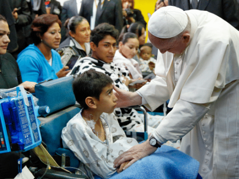 Pope Francis greets a sick child during a visit to the Federico Gomez Children's Hospital of Mexico in Mexico City, in February 2016. File photo: CNS