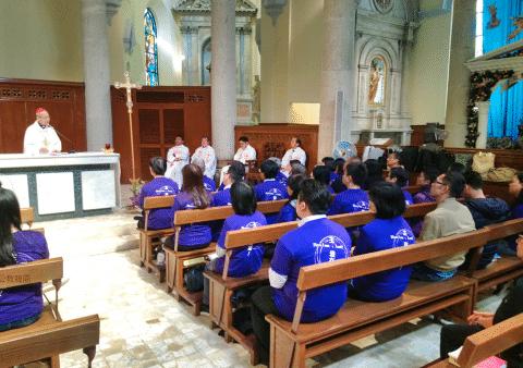 Cardinal Tong addresses the mission ambassadors on December 14.