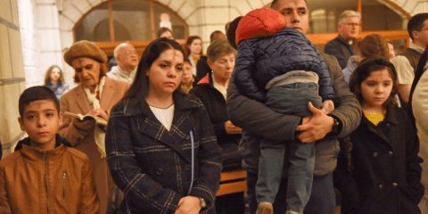 A family from of pilgrms from South America attends Ash Wednesday Mass at Our Lady of Peace Chapel in the Pontifical Institute Notre Dame of Jerusalem Centre on February 26. Photo: CNS