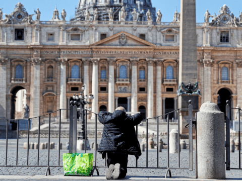 A solitary man in front of an empty St. Peter's Square on March 25, joins in the worldwide recitation of the Lord's Prayer, interceding for an end to the Covid-19 pandemic. Photo: CNS/Reuters