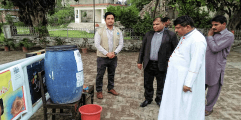 Bishop Indrias Rehmat of Faisalabad (second from right), with Father Abid Tanveer, vicar general of Faisalabad, and Aneel Mushtaq (left) at the installation of a hand-washing facility at the entrance to the Cathedral of Ss. Peter and Paul. Photo: UCAN/Aneel Mushtaq