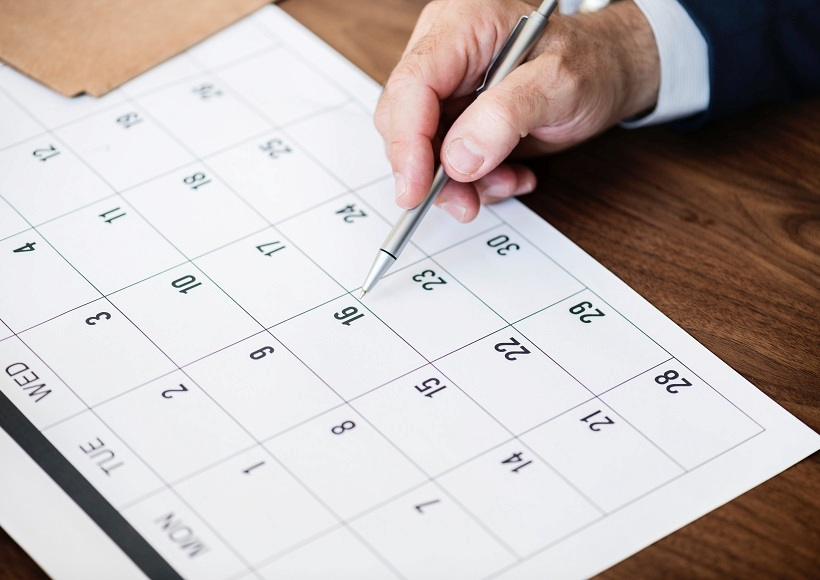 Person Pinpointing Pen On Calendar; Credit: Photo by rawpixel.com from Pexels