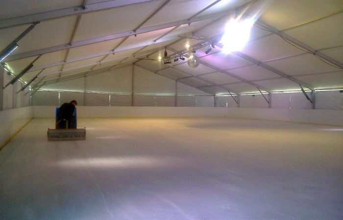 Temporary ice rink under a marquee with air conditioning