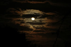 Clouds envelop the moon in this stunning night photo by Tom Bayly.