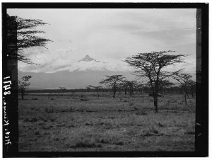In this black and white photograph, you can see Mount Kenya towering above the plains of the Kenya Colony.