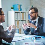Elegant businessmen communicating at meeting
