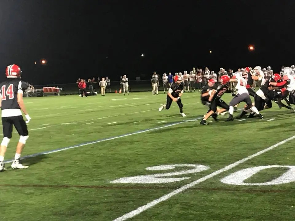 Action photo of a high school football game