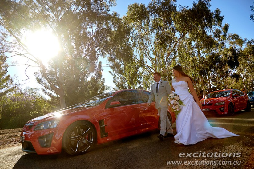 Late sunlight, a red car and bride and groom. Wedding photography near Mildura by Excitations.