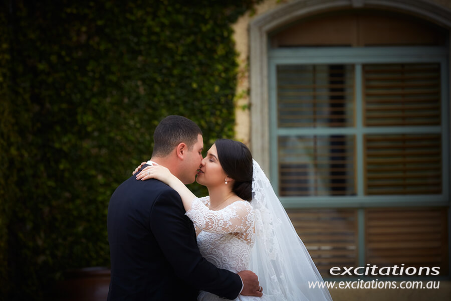 Casual bride and groom wedding portrait with stately home as a background. Wedding photography Mildura, by Excitations.