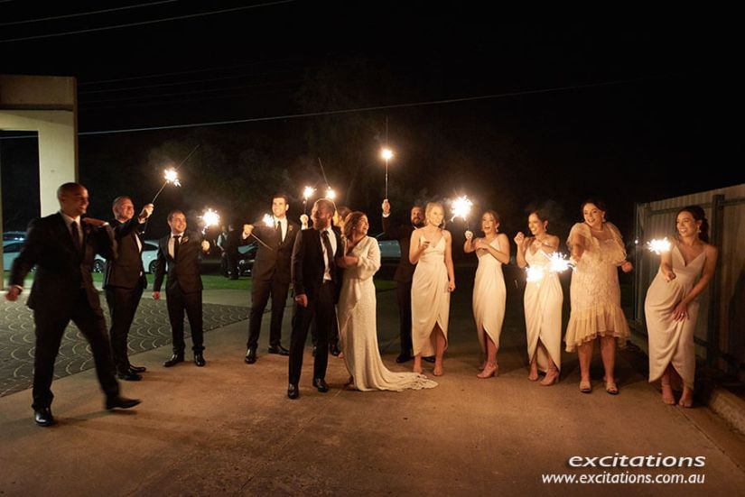 Bridal party holding sparklers at night. Married in Mildura wedding photography by Excitations, Mildura.