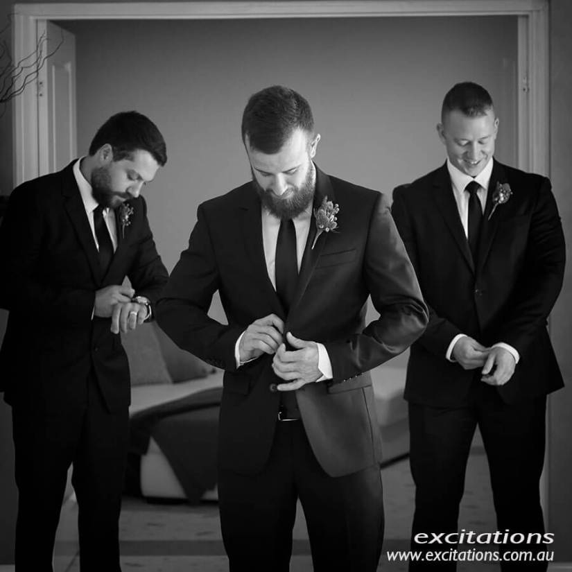 black and white photo of groom getting ready to be married in Mildura. Photo by Excitations Mildura wedding photographers