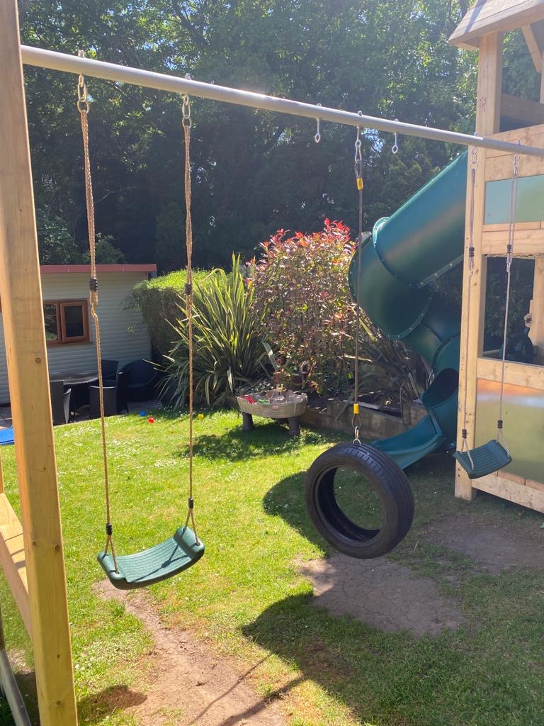exclusiveexteriors image of swings and slide