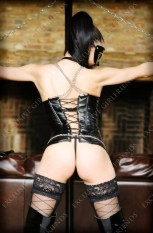 The Mistress rear view with chains and back leather outfit. Bondage, role-play fantasies and sissy maid training @ Exclusive Girlfriends