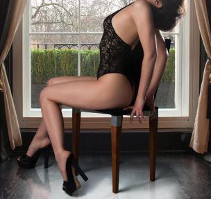 Eva posing on a chair