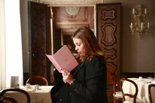 Chiara studying a brochure