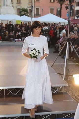 Sara in a vintage wedding dress for a fashion show