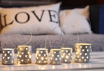 Tea-light holders with heart textures