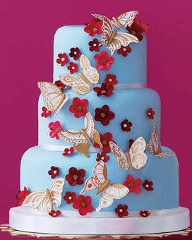 Wedding cake decorated with flowers and butterflies
