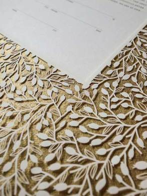 Papercut ketubah with leaves and gold paper