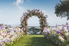 Outdoor wedding ceremony setup with sea view