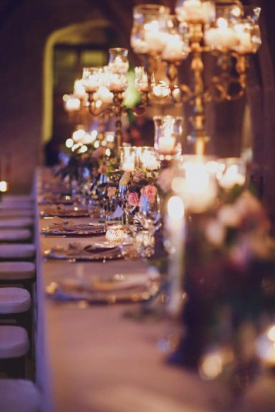 Romantic tablescape with tall candelabras for wedding reception