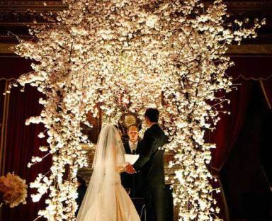Chuppah decorated with white flowers