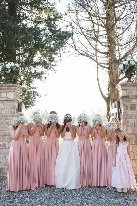Bride and bridesmaids in the gardens of Il Palagio in the Chianti region