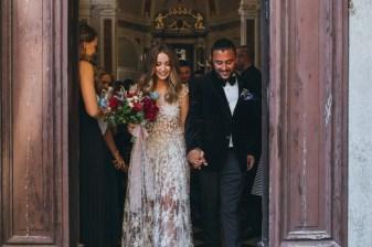 Bridal couple exits Catholic church in Tuscany
