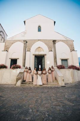 Bride and bridesmaids in front of Ravello church