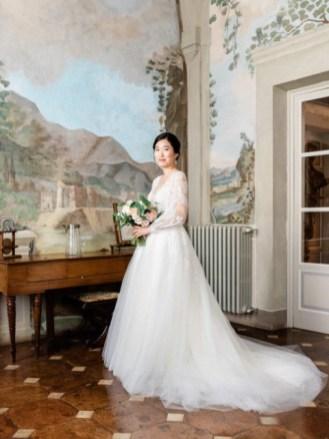 The bride in the frescoed hall of Villa Cetinale
