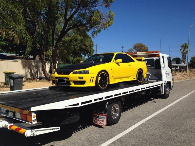 yellow car loaded onto an executive towing servoces truck in Perth WA